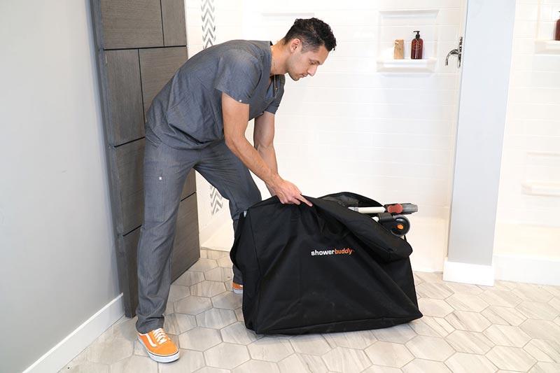 Eco Traveller SB7e with caregiver folded into travel bag