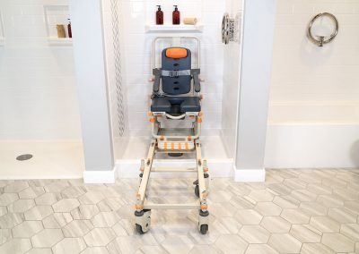 Petite-Buddy P1 on SB1 Frame with chair in shower