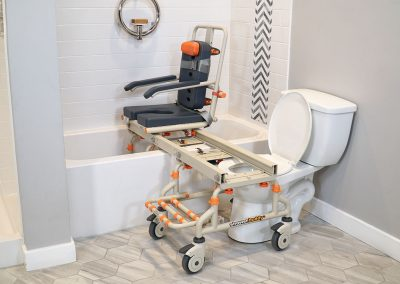 Petite-Buddy P1 on SB2 Frame with chair over bathtub