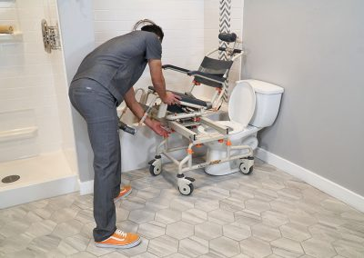 TubBuddy Tilt SB2T chair tilted with caregiver