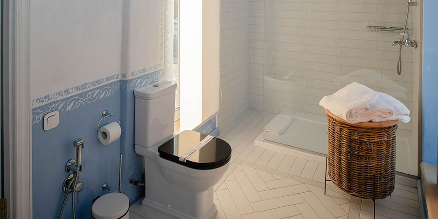mobility friendly bathroom with space for equipment and carers